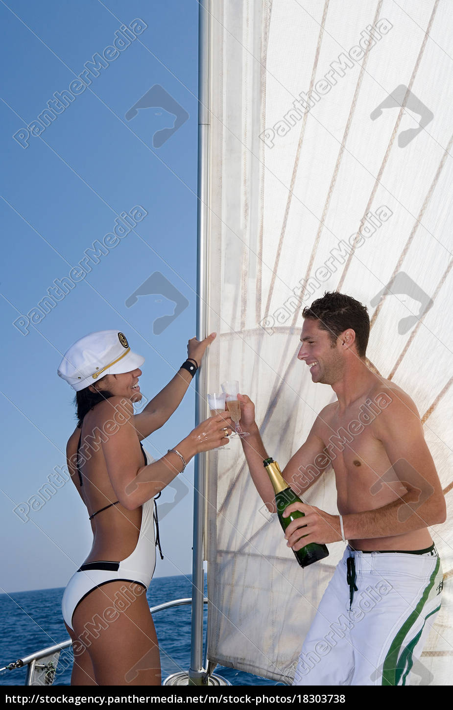 couple, making, a, toast, on, sailboat - 18303738