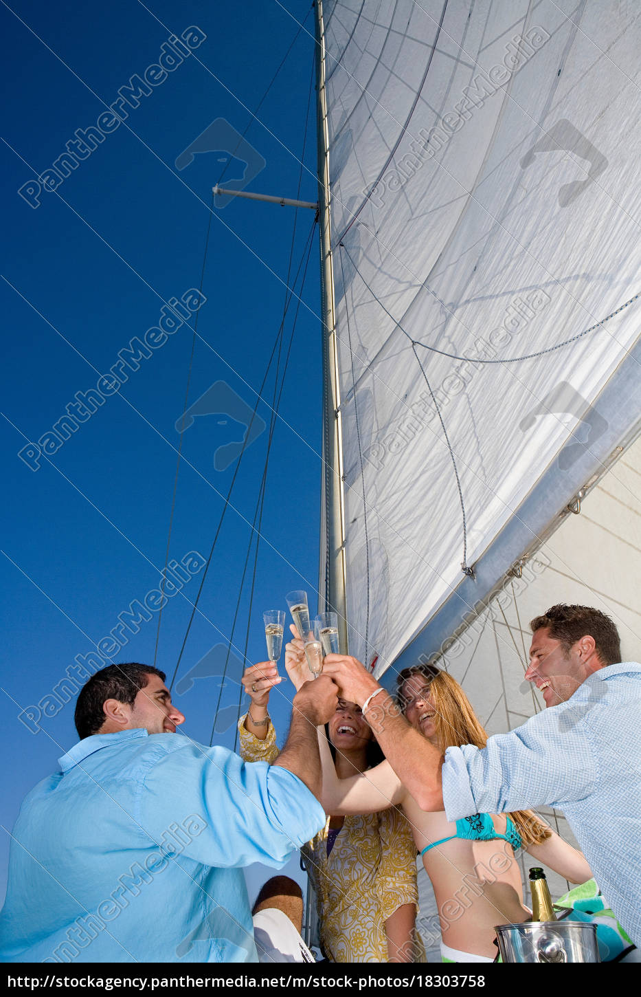 couples, making, a, toast, on, sailboat - 18303758