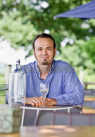 portrait of a man drinking wine