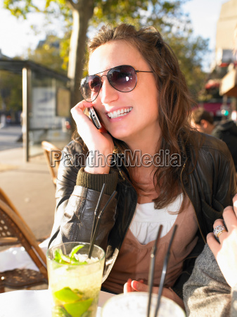 woman on phone on terrace of