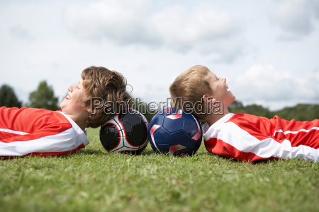 two boys resting with heads on