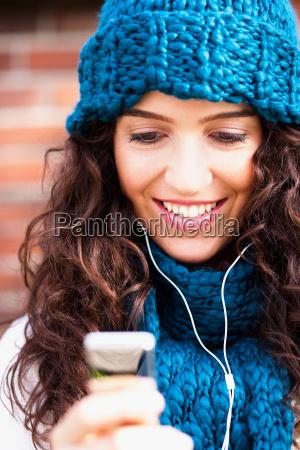 young woman hearing music
