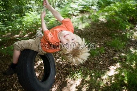 boy on tire swing