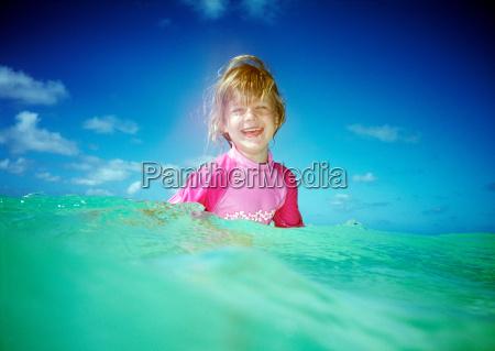 girl in sea looking at camera