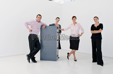 a business group with filing cabinet