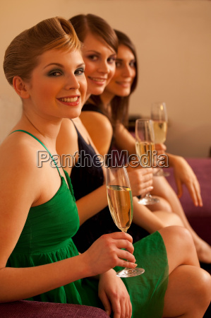 young women drinking champagne