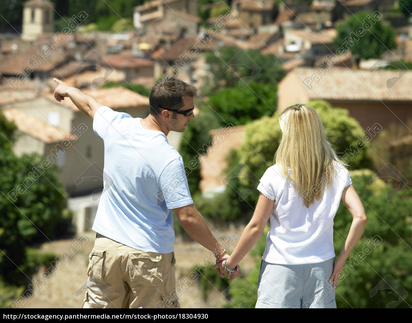 rear, of, couple, looking, at, view - 18304930