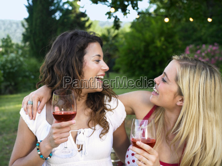 two women laughing at barbecue