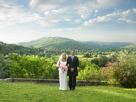 wedding couple in sunlit garden