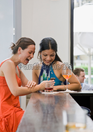 girls looking at text message