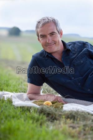 man sitting on grass smiling
