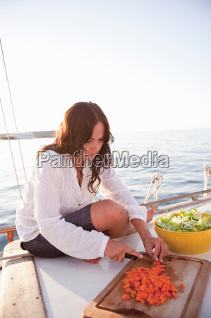 woman on boat preparing food