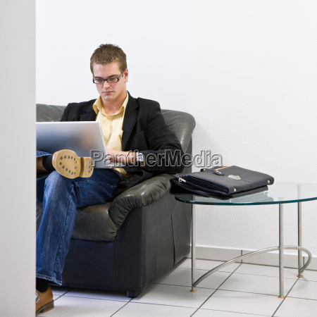 man on laptop in office