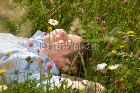 man lying in grass with spring