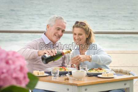 couple dining at seaside restaurant