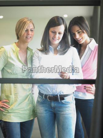 women at office window