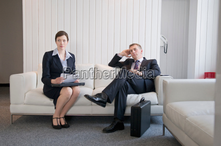 a, business, couple, waiting, in, reception - 18305098
