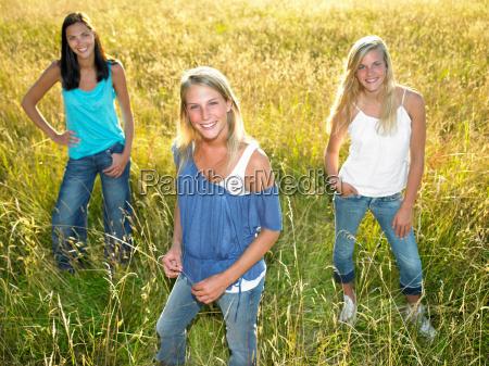 women standing in a field