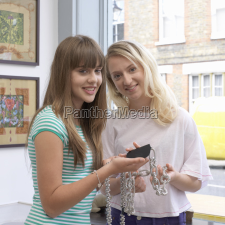 2 young women in a shop