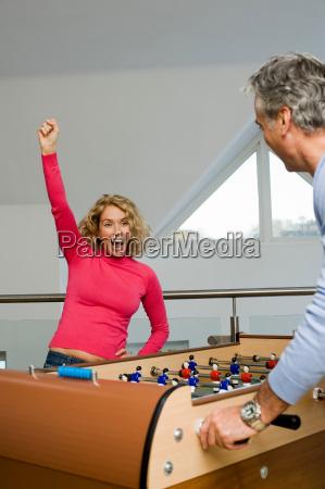 couple having fun playing table football