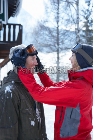 young couple in front of chalet