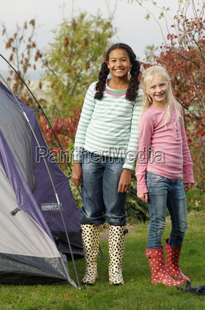 two girls with tent