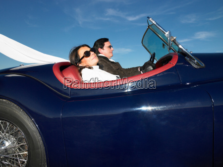 couple in an old convertible