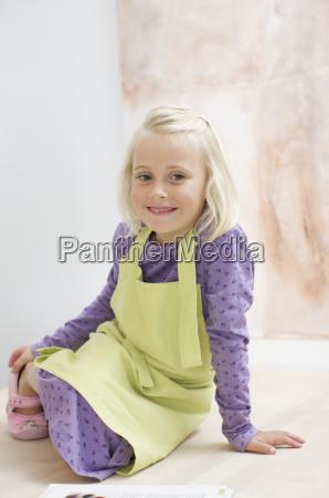 girl wearing apron