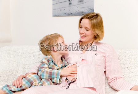 pregnant woman and boy laughing