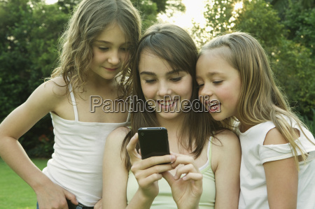 girls looking at photo on phone