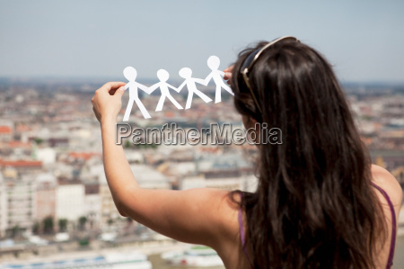 woman cut out paper people