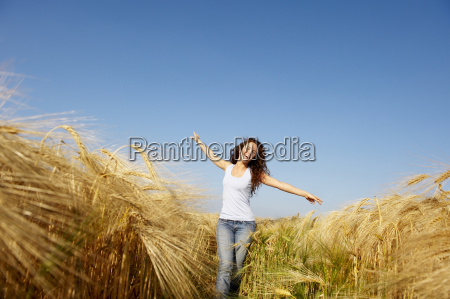 woman walking in a wheat field