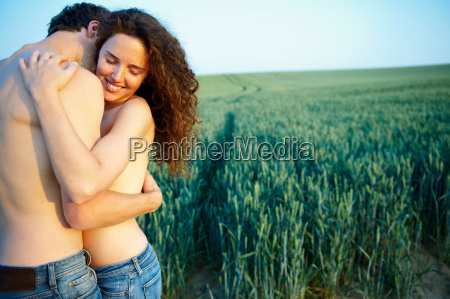 topless couple holding each other