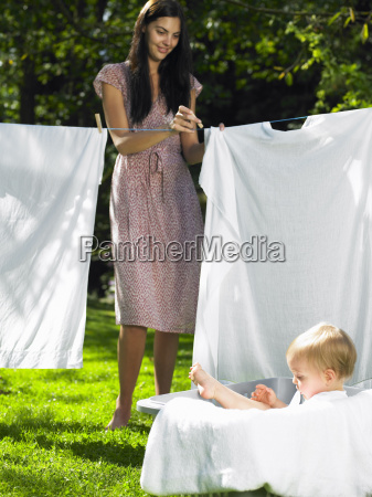 mother and son doing the laundry