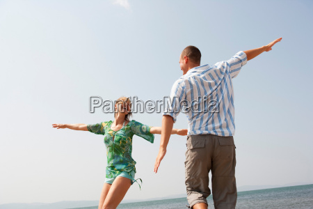 young couple playing air plain