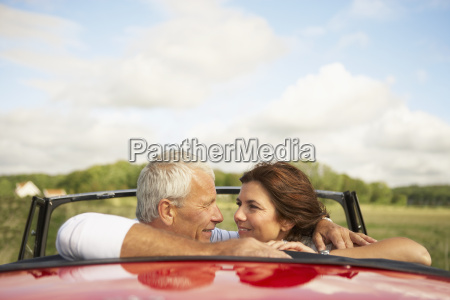 couple in car over shoulder