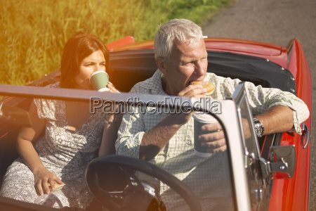 couple with car coffee break