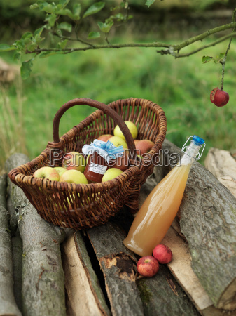 apples in basket with jar and