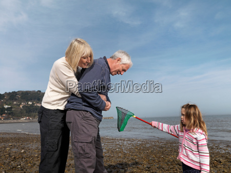 mature couple with child on beach