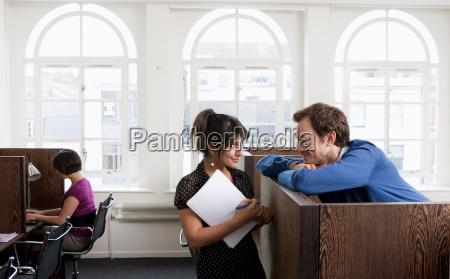couple flirting in business center