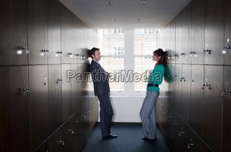 business couple in locker room