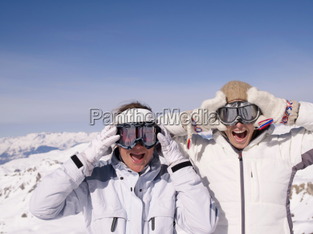 two women in skiing clothes making