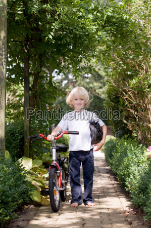 child with first bicycle