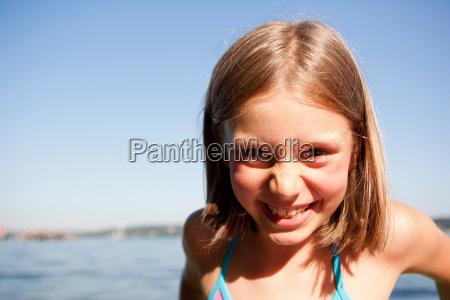 young girl at lake