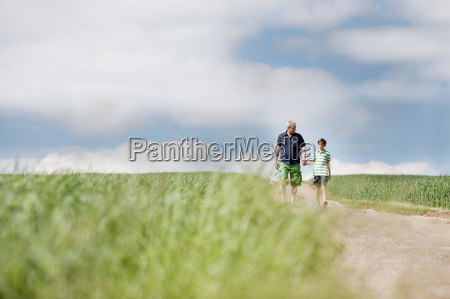 father and son walking down a