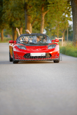 couple in an electric sports car
