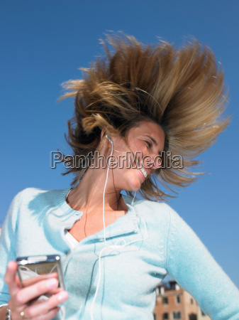 woman listenning to mp3 player dancing