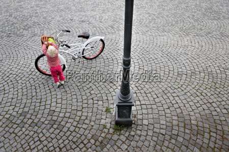 little child taking fruit out of