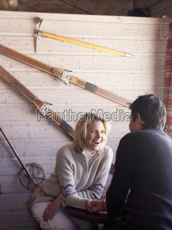 man and woman sitting at ski