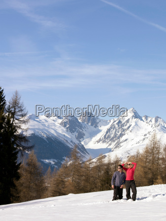 woman and man in snow on